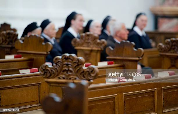 Sisters with their Habits sit in a pew behind empty pews at the closing mass service of the Fall General Assembly of the German Bishops' Conference...