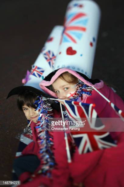 Sisters Zohra Ferragh , aged five and Olivia Ferragh, aged 10, of Fulham, London, pose on the The Mall as thousands gather for The Diamond Jubilee...
