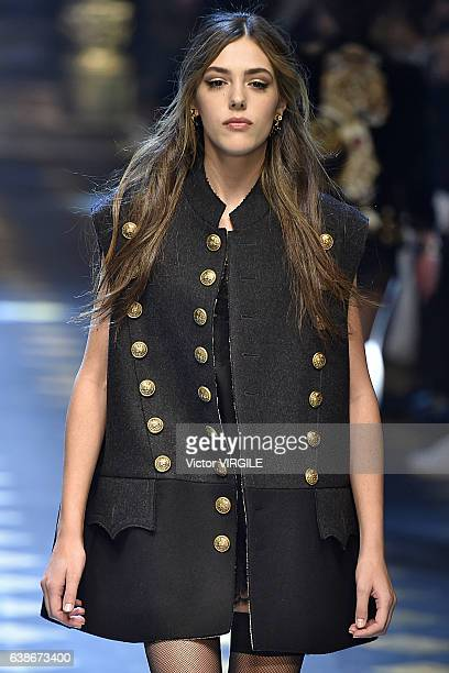 Sistine Stallone walks the runway at the Dolce Gabbana show during Milan Men's Fashion Week Fall/Winter 2017/18 on January 14 2017 in Milan Italy