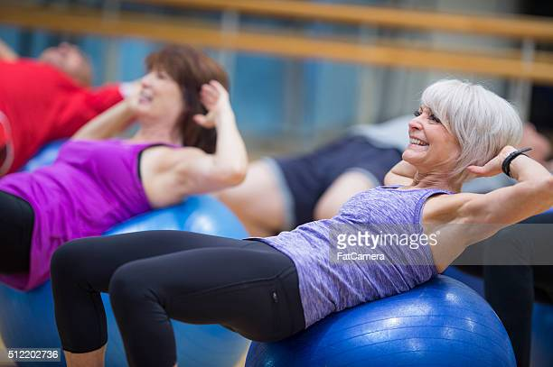 sit ups on an exercise ball - sit ups stock photos and pictures