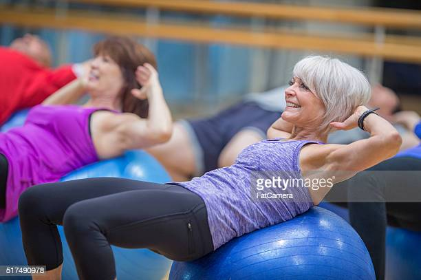 Sit Ups on Exercise Balls at the Gym