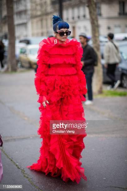 Sita Abellan is seen wearing red dress outside Valentino during Paris Fashion Week Womenswear Fall/Winter 2019/2020 on March 03 2019 in Paris France