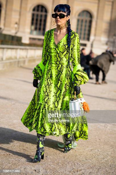 Sita Abellan wearing a snake print green dress printed boots and white bag is seen in the streets of Paris before the OffWhite show on January 16...