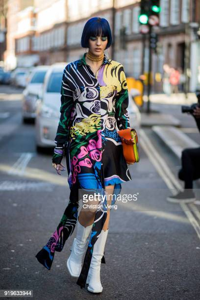 Sita Abellan wearing dress with floral print JW Anderson bag white boots seen outside JW Anderson during London Fashion Week February 2018 on...
