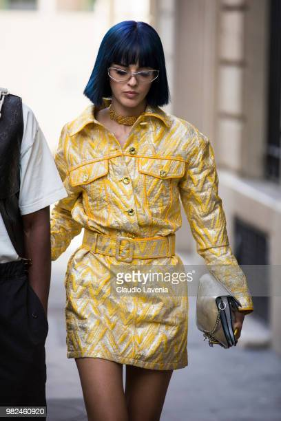 Sita Abellan, wearing Moschino golden dress and J.W. Anderson bag, is seen in the streets of Paris before the Dior Homme show, during Paris Men's...