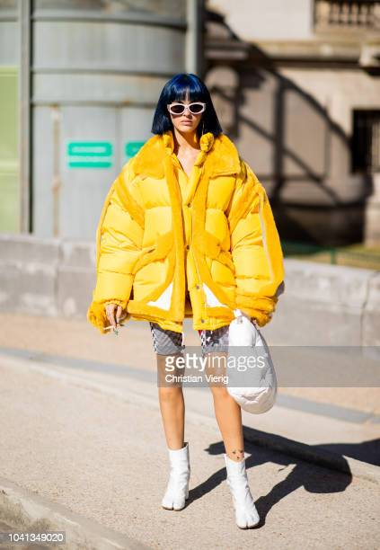 Sita Abellan wearing yellow puffer jacket is seen outside Maison Margiela during Paris Fashion Week Womenswear Spring/Summer 2019 on September 26...