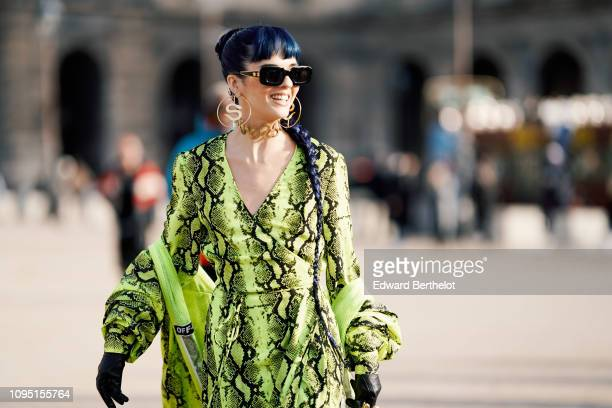 Sita Abellan wears a green snake print dress outside OffWhite during Paris Fashion Week Menswear F/W 20192020 on January 16 2019 in Paris France
