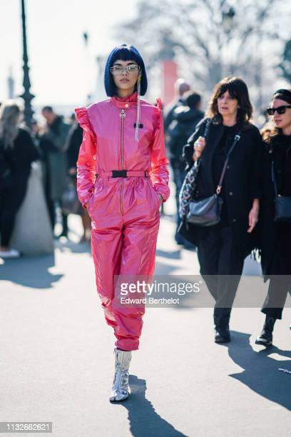 Sita Abellan wears glasses, a pink shiny outfit with ruffles, silver shoes, outside Maison Margiela, during Paris Fashion Week Womenswear Fall/Winter...