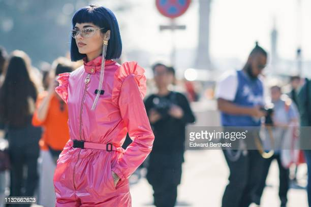 Sita Abellan wears glasses, a pink shiny outfit with ruffles, silver shoes, outside Maison Margiela, during Paris Fashion Week Womenswear Fall/Winter...