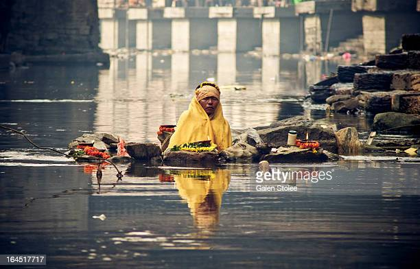 Sita Rai sits partially submerged in the frigid waters of the Bagmati river at the Pashupatinath ghats in Kathmandu, Nepal. She will sit for one week...