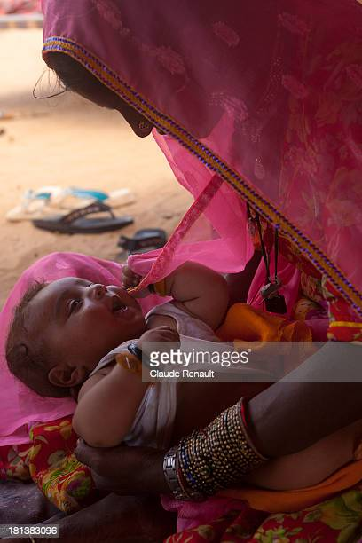CONTENT] Sita taking care of Rajuri's baby brother in their tents outside Pushkar