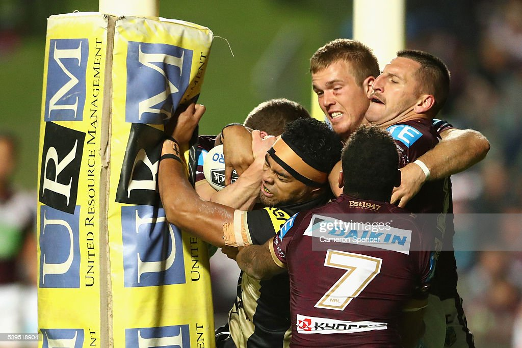Sitaleki Akauola of the Panthers is held up in goal during the round 14 NRL match between the Manly Sea Eagles and the Penrith Panthers at Brookvale Oval on June 12, 2016 in Sydney, Australia.