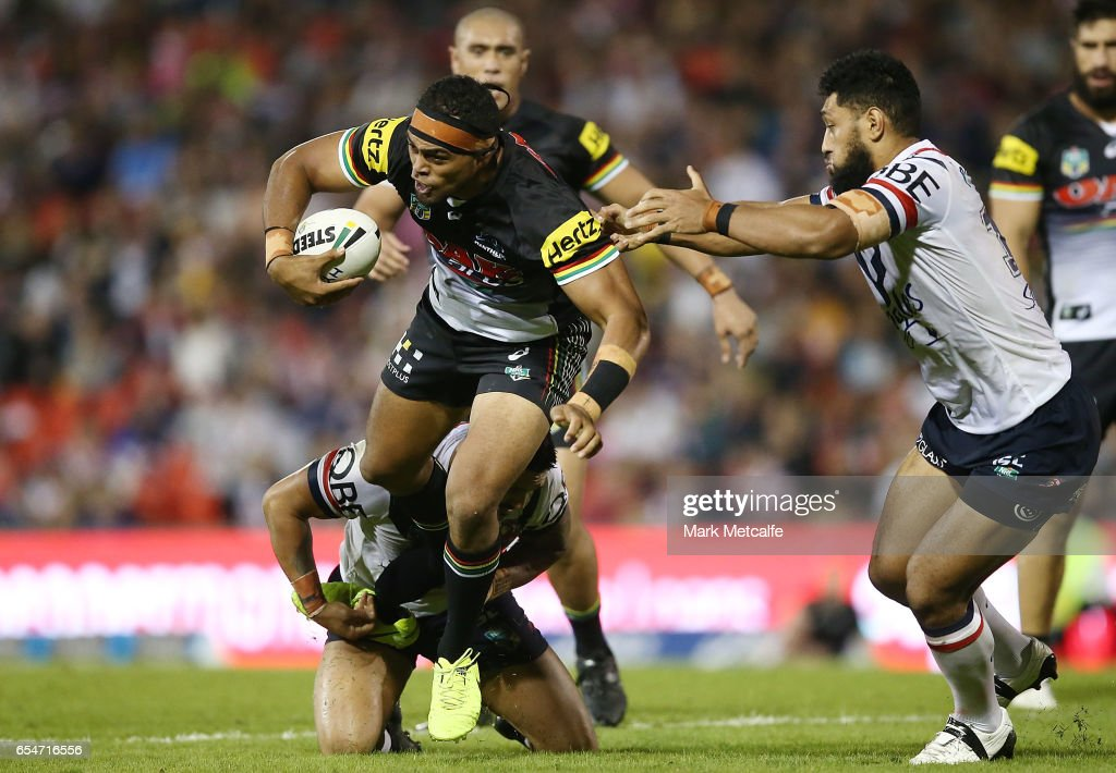 Sitaleki Akauola of the Panthers is tackled during the round three NRL match between the Penrith Panthers and the Sydney Roosters at Pepper Stadium on March 18, 2017 in Sydney, Australia.