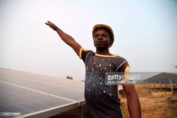 Site engineer Alassani Damoni speaks about the solar panels installed in the Takpapieni village in Oti province northern Togo on February 14 2020 The...