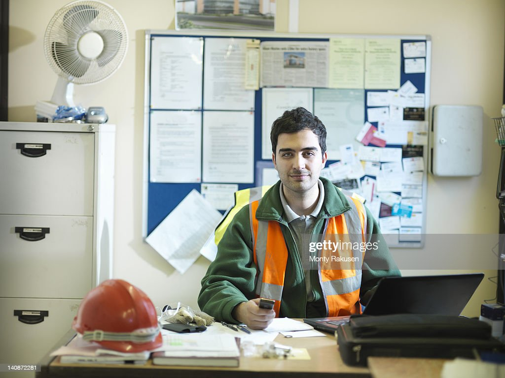 Site Foreman At Desk In Office Of Building Site High-Res ...