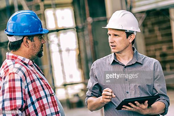 Site manager with construction foreman