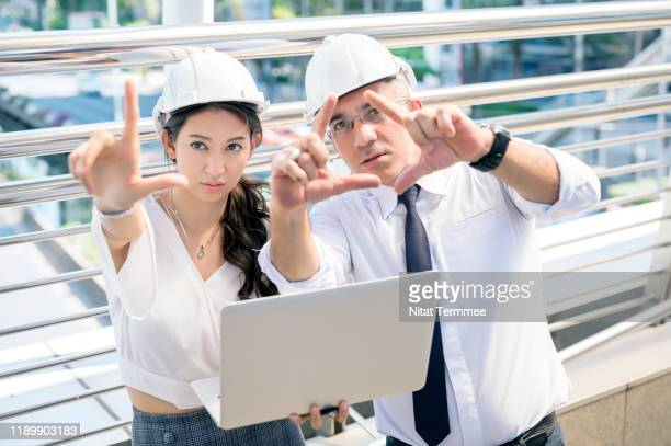 site managers and secretary makeing a decision on construction project. - zakelijke kleding stock pictures, royalty-free photos & images