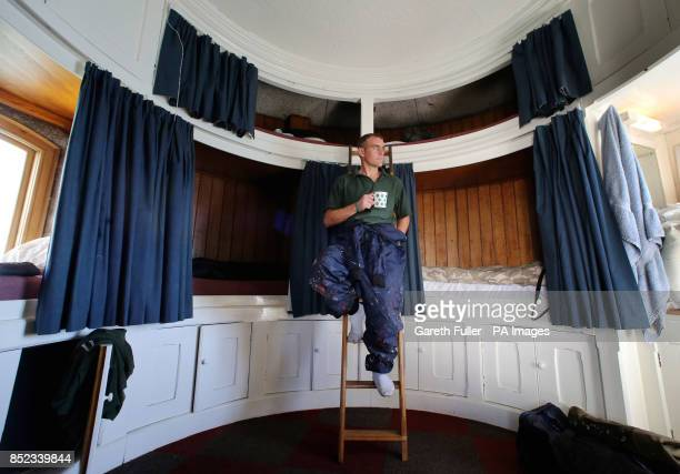 Site Supervisor Paul Culyer takes a tea break in the curved sleeping accomodation in Beachy Head Lighthouse in Eastbourne Sussex as the final touches...