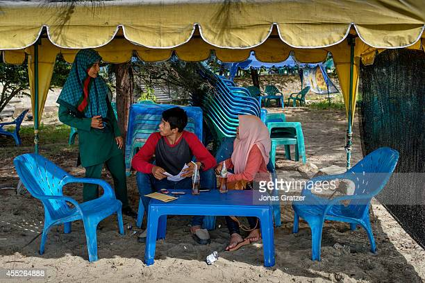 Siti Habiyah a member of Banda Aceh's Sharia women police making sure that two lovebirds don't do anything immoral The tsunami of December 2004 was...