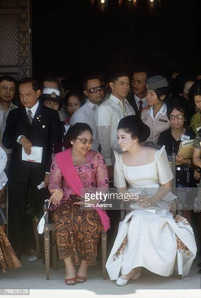 Siti Hartinah the wife of President Suharto of Indonesia with Imelda Marcos the wife of President Ferdinand Marcos of the Philippines in Manila...