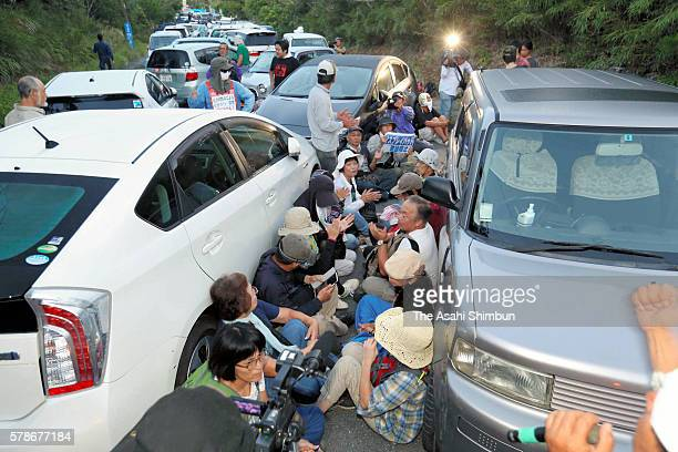 Sitin protesters against the relocation of the US helipads block a road leading to the constuction site of the US helipads on July 22 2016 in Higashi...