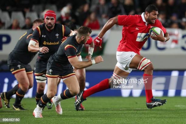 Sitiveni Mafi of Tonga makes a break from Gareth Davies of Wales during the International Test Match between Tonga and Wales at Eden Park on June 16...