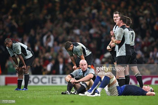 Sitiveni Sivivatu, Luke McAlister, Brendon Leonard, Ali Williams, Tony Woodcock and Richie McCaw of New Zealand are dejected following their defeat...