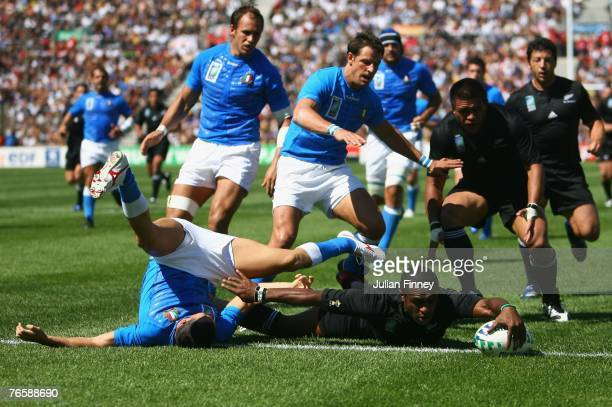 Sitiveni Sivivatu of New Zealand scores his team's sixth try during Match Two of the Rugby World Cup 2007 between New Zealand and Italy at the Stade...