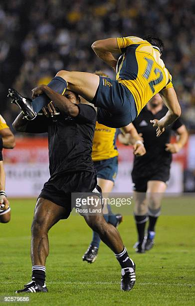 Sitiveni Sivivatu of the All Blacks makes an illegal tackle on Adam AshleyCooper of the Wallabies during the 2009 Bledisloe Cup match between the New...