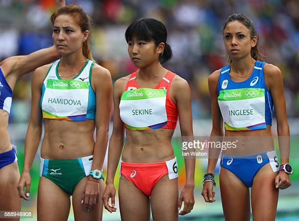 Sitora Hamidova of Uzbekistan Hanami Sekine of Japan and Veronica Inglese of Italy prepare to compete in the Women's 10000 metres final on Day 7 of...