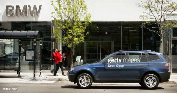 X3 sits in front of Perillo BMW May 5 2004 in Chicago Illinois BMW posted a 25 percent rise in first quarter profit from a year ago helped by sales...