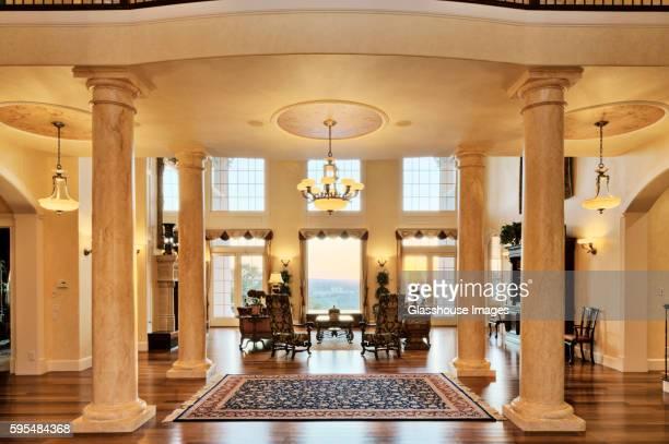 Sitting Area Between Columns of Opulent House
