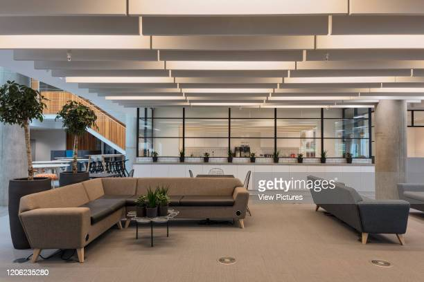 Sitting area next to staff kitchen. YOOX Net-A-Porter Offices, London, United Kingdom. Architect: Grimshaw, 2017.