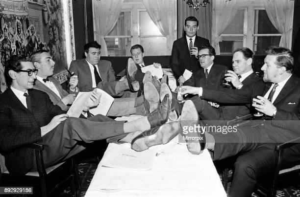 Sitting around the table are comedy writers Denis Norden Frank Muir Alan Simpson Bernard Braden Dennis Goodwin Sydney Green RM Hills and Alan Tarrant...