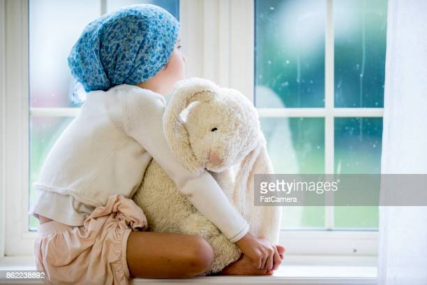 sitting at the windowsill - cancer stock photos and pictures