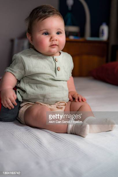 sitting baby in vintage clothes for photo shoot - one baby boy only stock pictures, royalty-free photos & images