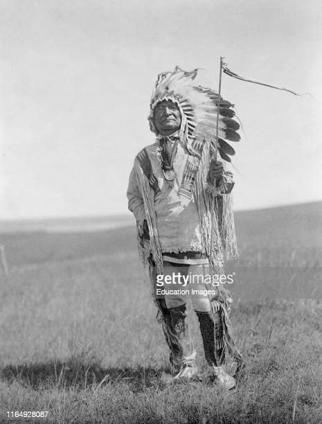 Sitting Bear, Arikara Chief, Full-Length Portrait in full Regalia, Edward S Curtis, 1908.