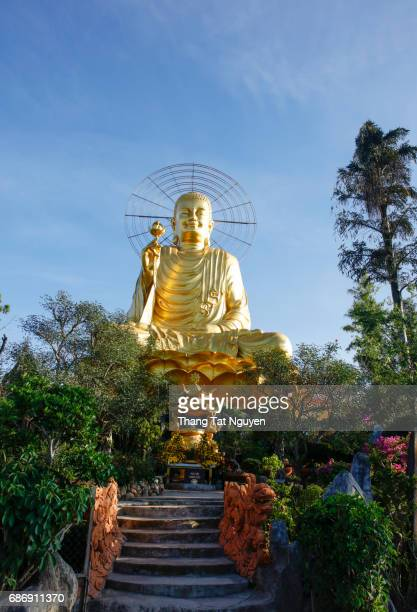 Sitting buddha on blue sky
