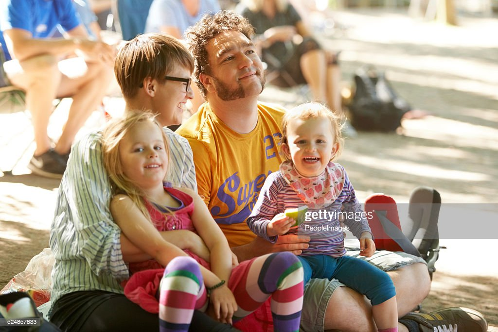 Sitting down to watch the bands : Stock Photo