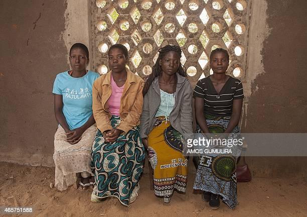 Yvone Kambiza Alinafe Naison Catherine Julio Funsani and Katrina Kampingo who were underage brides sit on March 7 2015 inside a hall at the Gender...