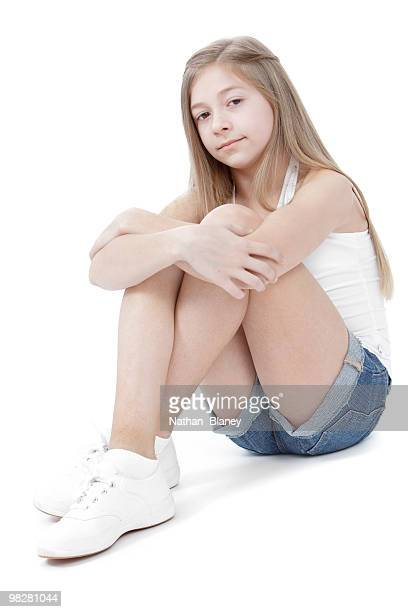 sitting girl. - hot pants stock photos and pictures