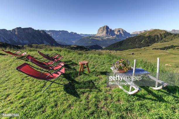 Sitting in front of Secede in summer, Dolomite, Italy