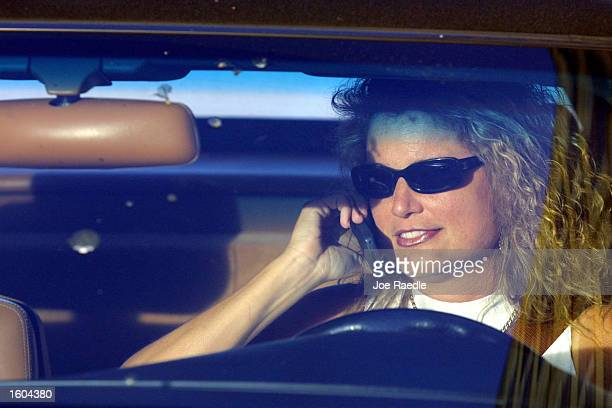 Sitting in her car a driver chats on her cell phone July 25 2001 in Miami Florida MiamiDade commissioners took the first step Tuesday toward...