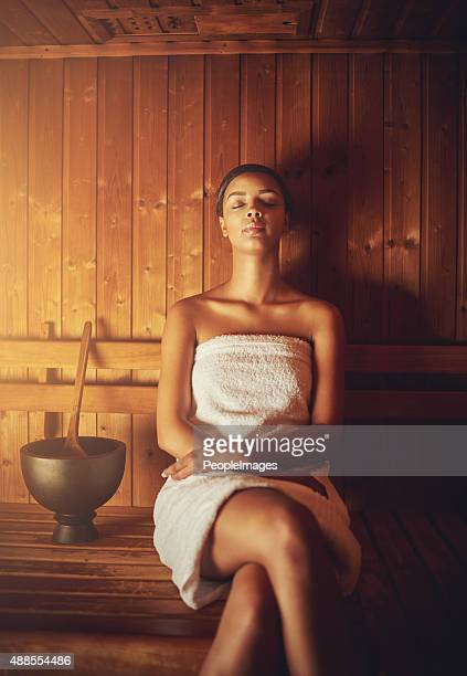 sitting in the sauna - black woman in sauna stock pictures, royalty-free photos & images