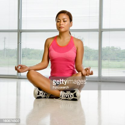 sitting in yoga lotus position with eyes closed highres