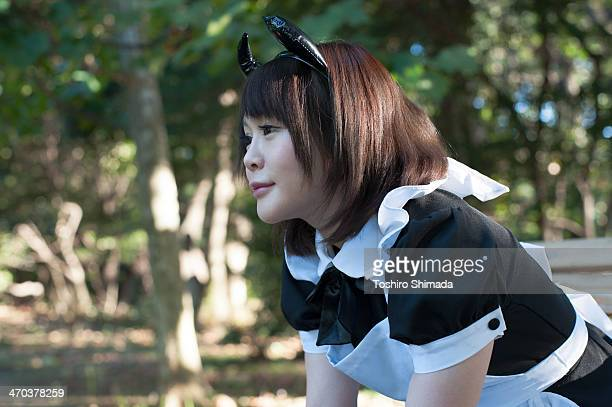 A sitting Japanese maid