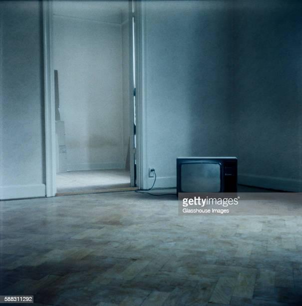 TV Sitting on Floor in an Empty Room