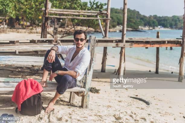 Sitting on the beach and enjoying the sun