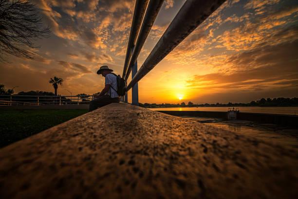 Sitting on the Dock of the Lake,San Antonio,Texas,United States,USA