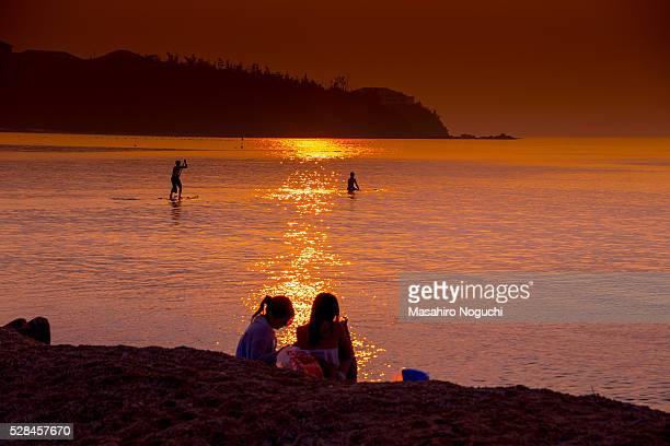 Sitting on the evening beach, at Koki Beach, Okinawa